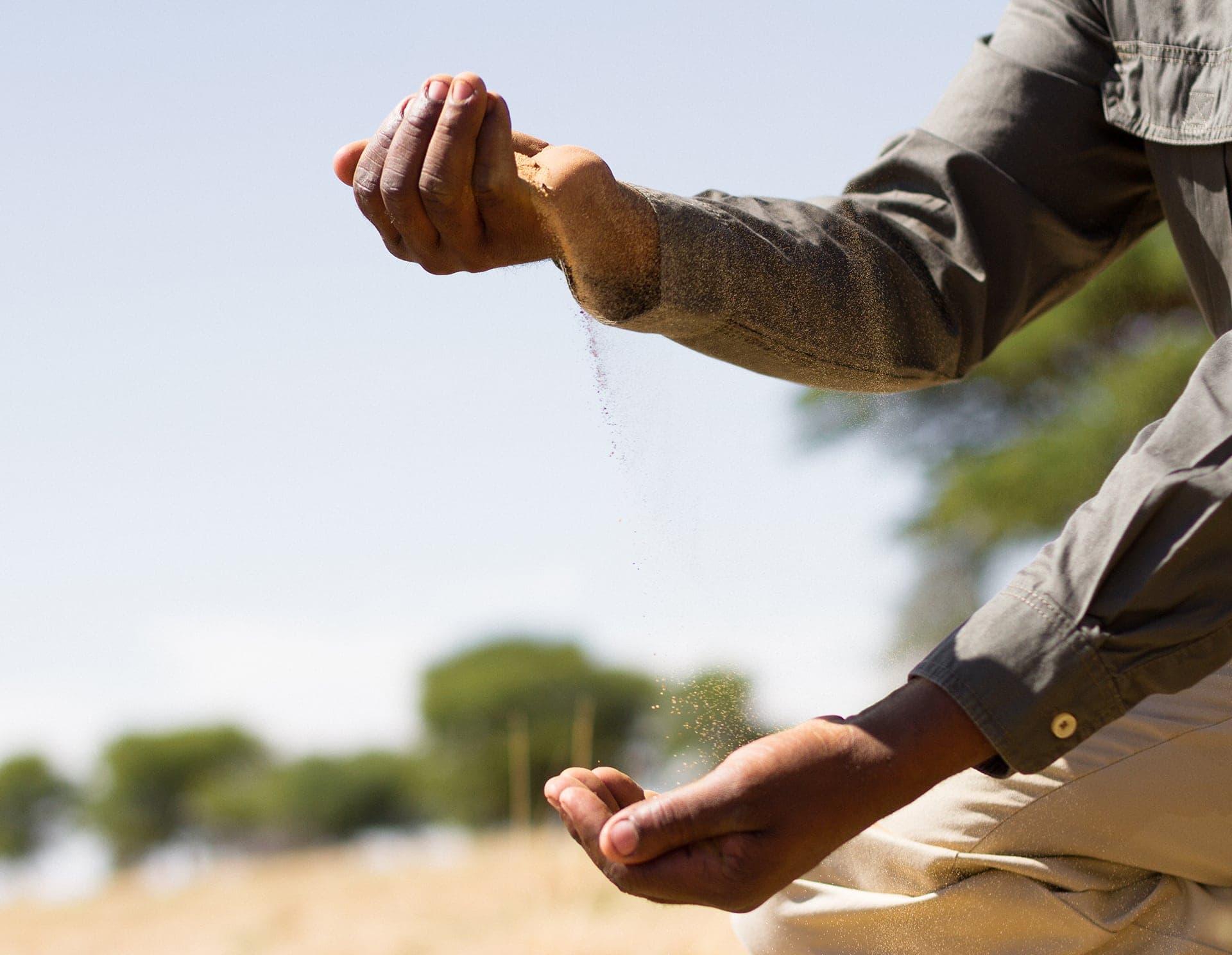 sand through hands